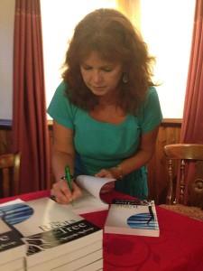 Amanda signing books